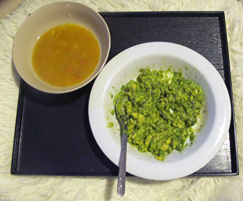 Avocado mush and chicken-carrot soup on the side