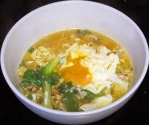 Kimchi Noodles with egg and homegrown veggie.