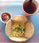 Poor scholar's lunch - egg & potato mash, rice cakes, tea and a small serving of choco mousse!