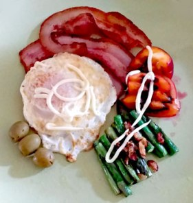 Bacon and egg with asparagus, garlic, olives and tamarillo