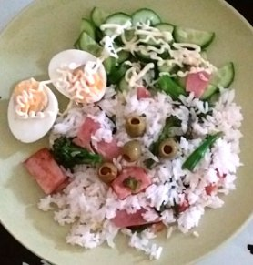 Rehashed bacon rice with boiled egg and cucumber