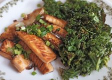 Salmon slices with toasted baby kale.