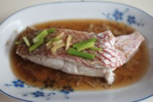Steamed red snapper with soy sauce, ginger & spring onion.