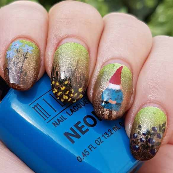 A picture of freehand nail art, done on my own nails using nail polishes, showing a drawing of a small gnome with a bright red hat, surrounded by berries and flowers, on a green to brown gradient background