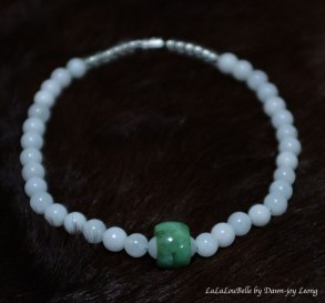 Small white moonstone beads with Chinese jade ring.