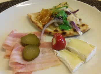 Blended diversity - Naan bread, belly ham & soft cheeses.